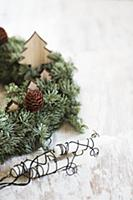 Wreath decorated with wooden Christmas trees next