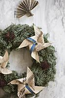 Wreath decorated with windmills made from yellowed
