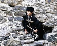 Молодой человек в национальном костюме. В горах Че